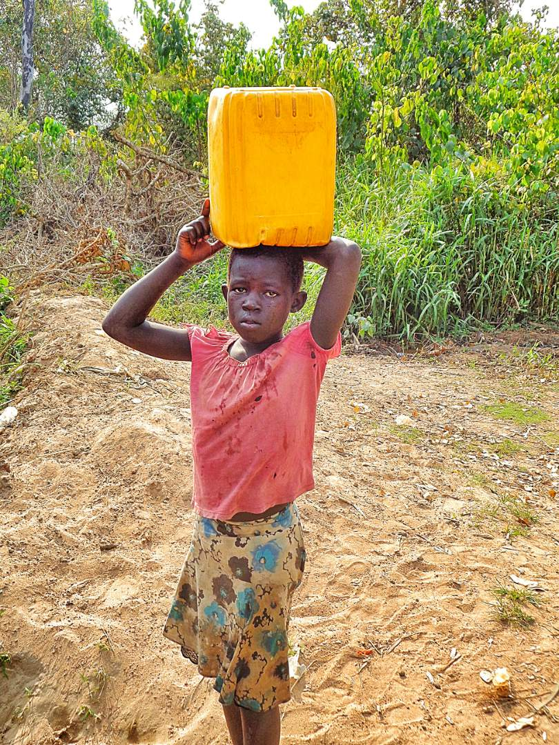 A Child Carrying Water