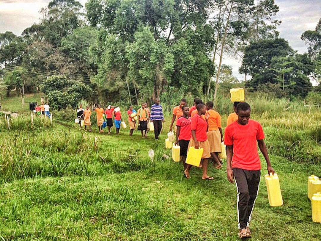 Students carrying water