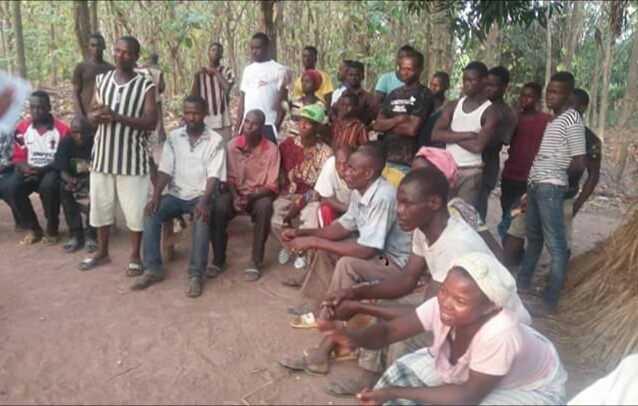 Villagers discussing the project