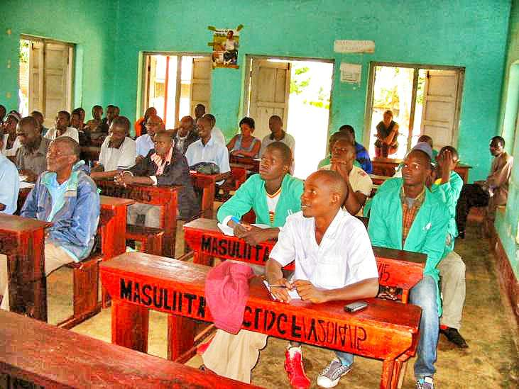 Borehole maintenance class with water committee members in Masulita.