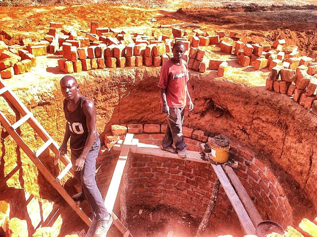 Men Building the Well