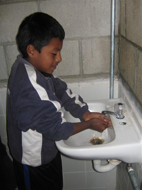 Boy using new sink