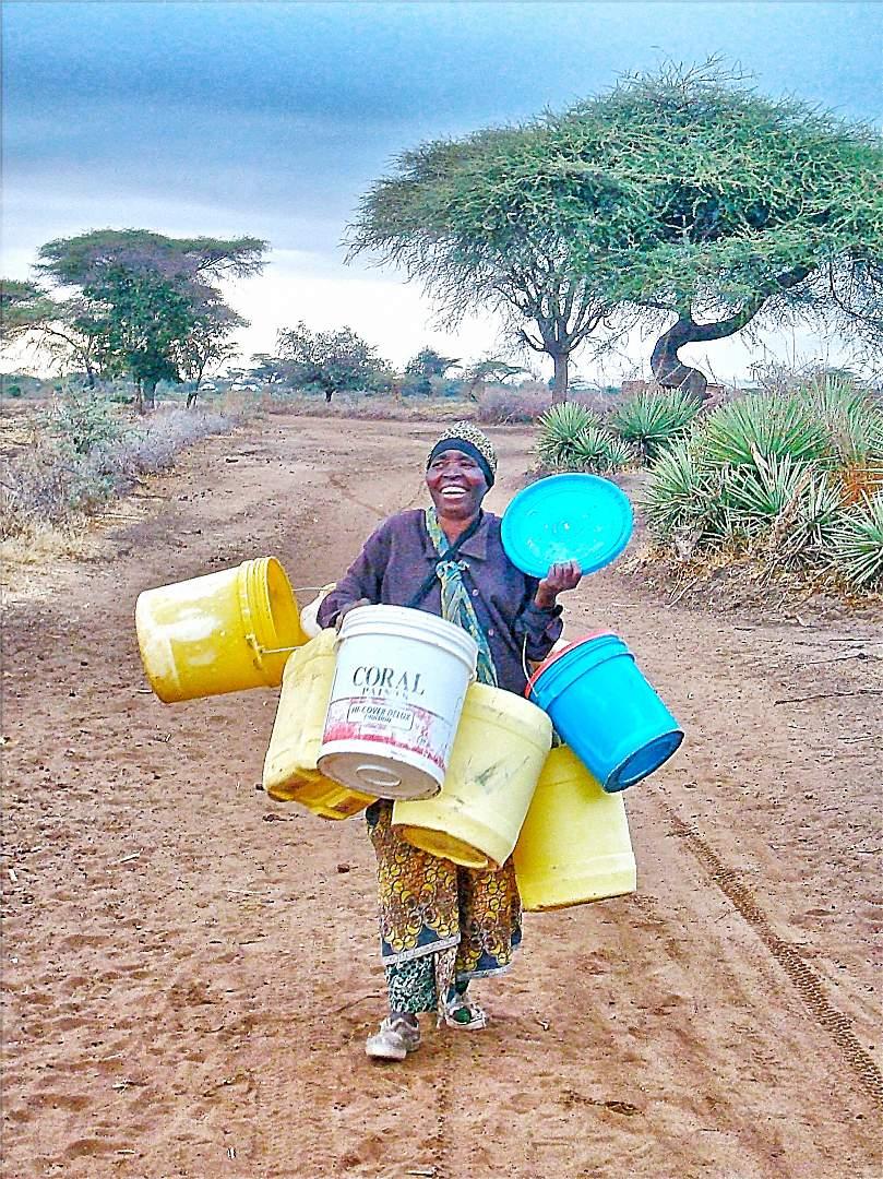 Village Woman carrying many water jugs