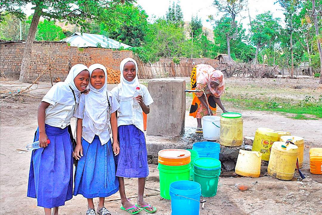 girls at the water pump