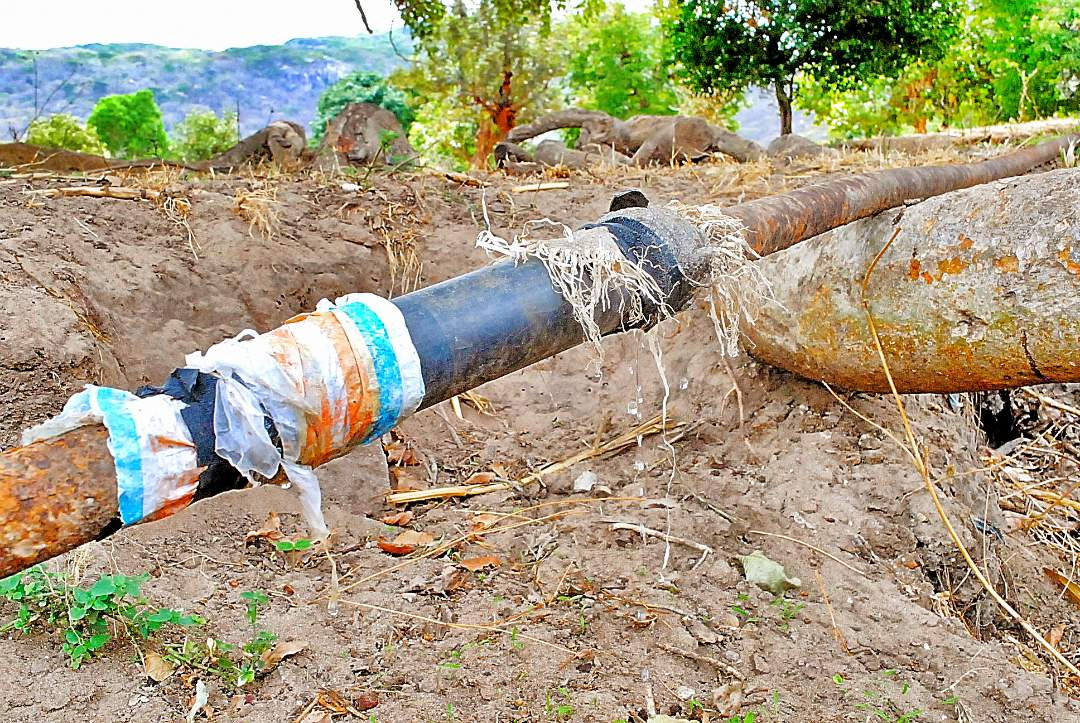 broken pipe repaired with plastic bags
