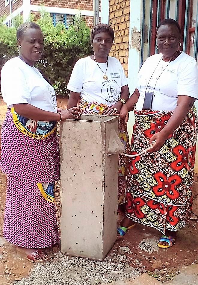 Three Women with BioSand Filter