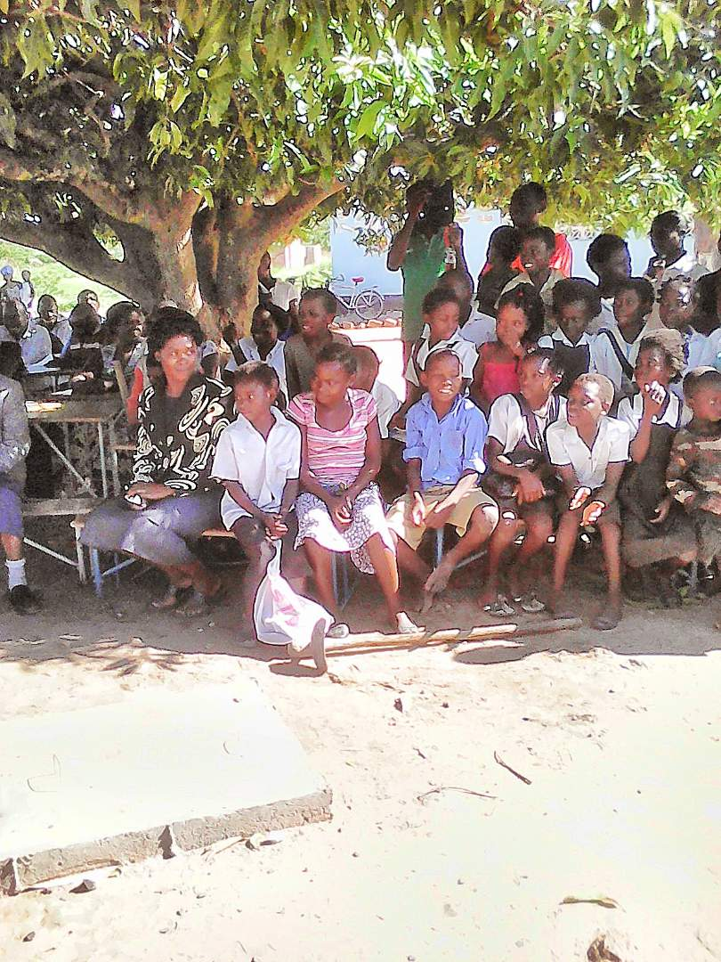 A teacher and pupils at Fimpulu Primary School