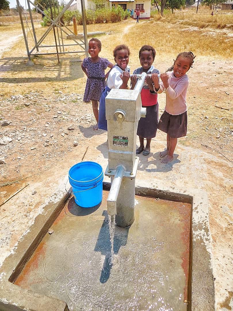 Children at the water  pump