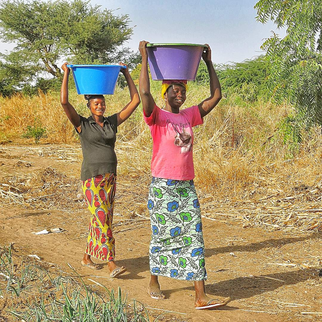 Village women carrying water