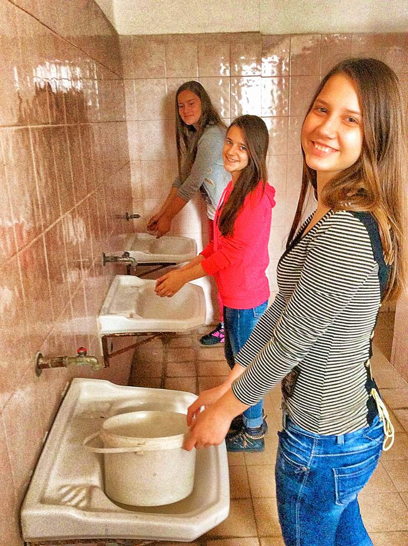 Female students washing their hands