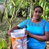 Village woman using her water filter