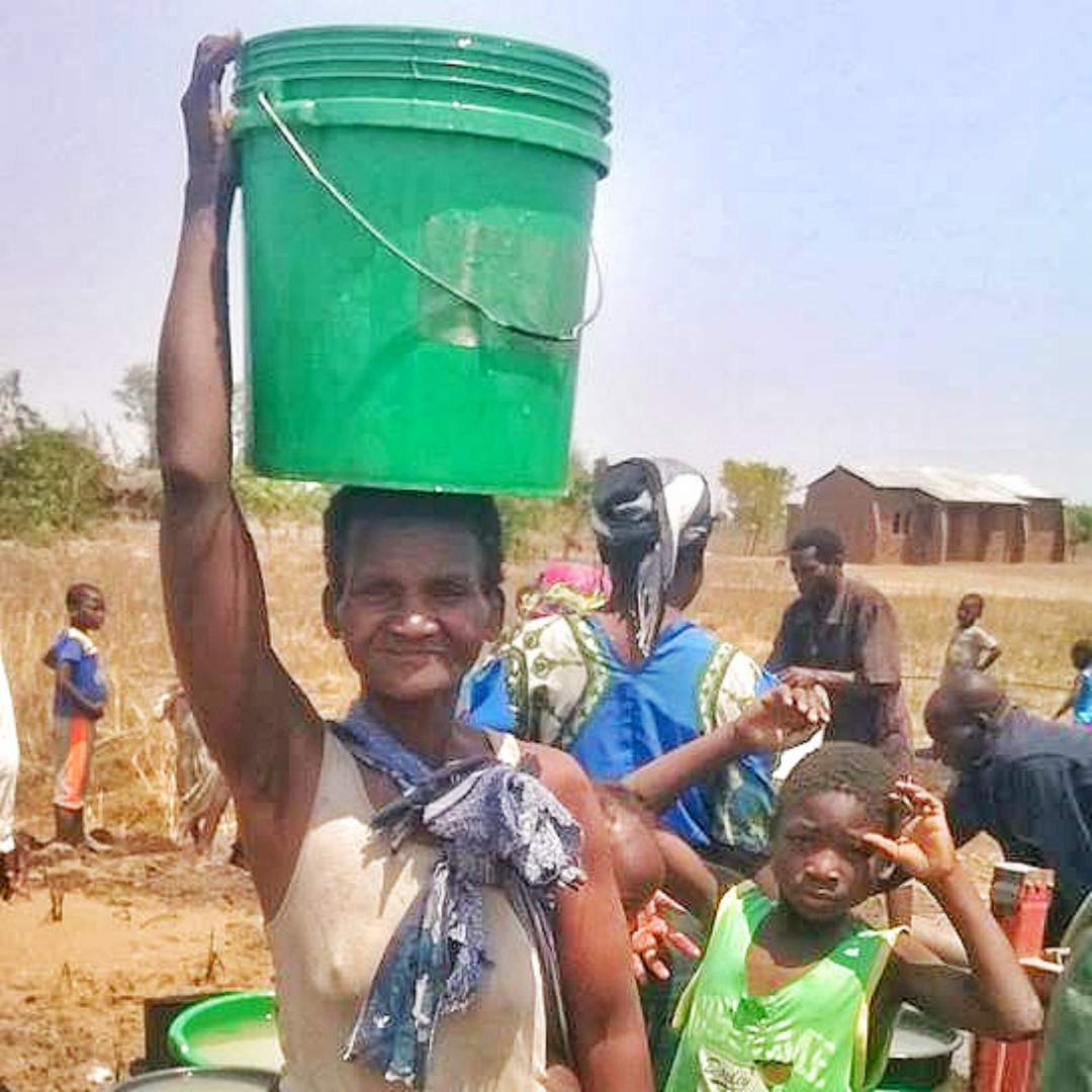 Mother carrying water