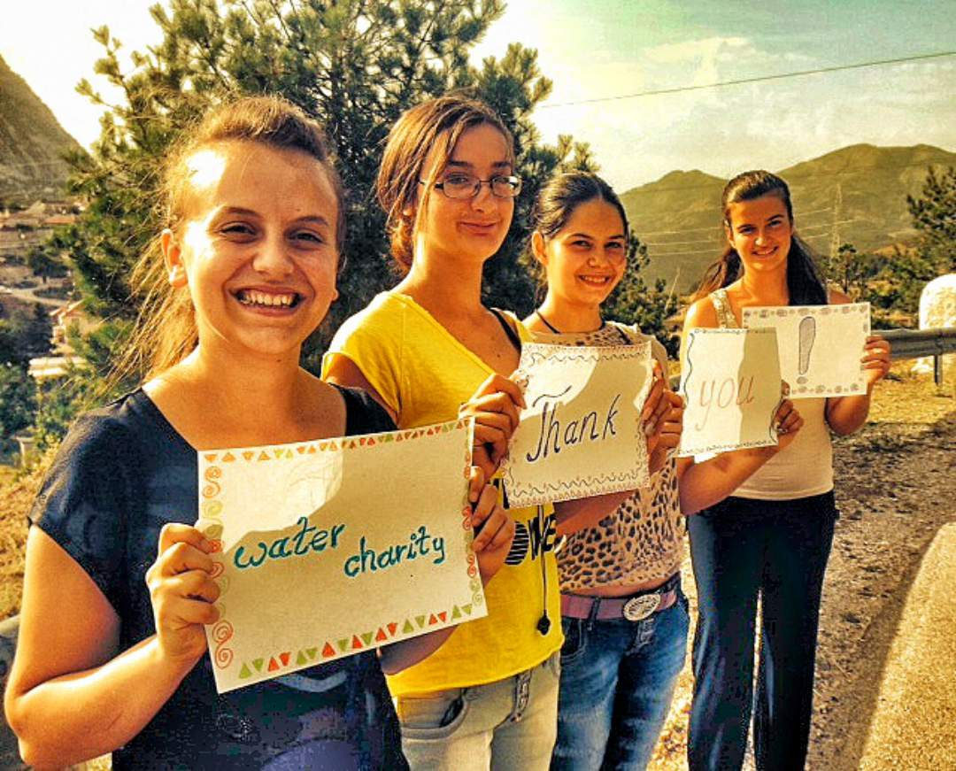 Female Students thanking Water Charity