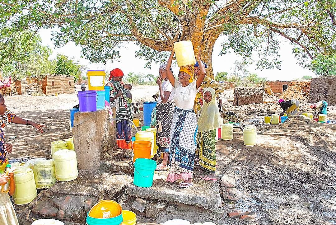 Village women filling their water jugs